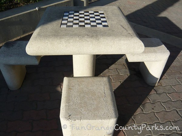concrete table and benches with built-in chess/checker board