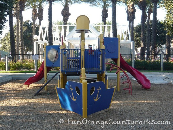 38th Street playground with blue bow of ship and view of play structure
