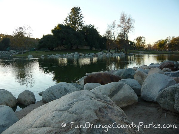 mason regional park irvine - lake with boulders surrounding shore