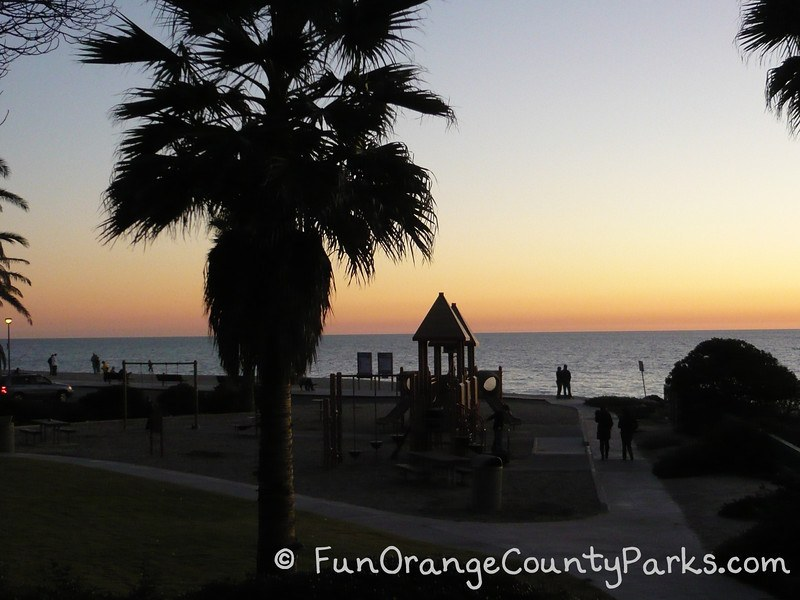Aliso Beach Park view of sunset with palm trees