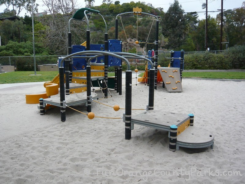 play area for younger kids with balancing and climbing apparatus