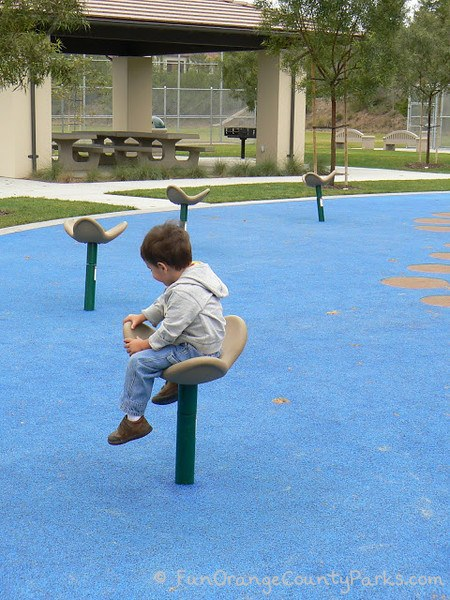 playgrounds spinners with little boy