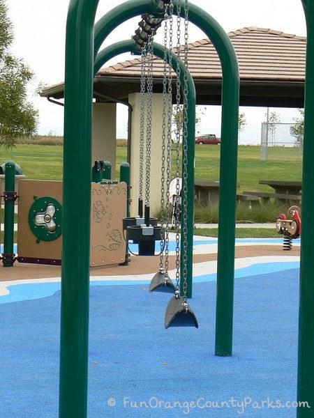 bench swings and baby swings at coastal peak park in newport beach