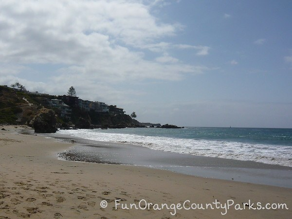 Sand and waves at Corona del Mar State Beach