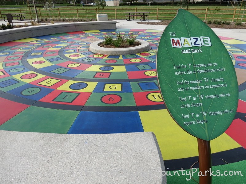 maze game with colorful concrete stamped with letters and numbers in concentric circles