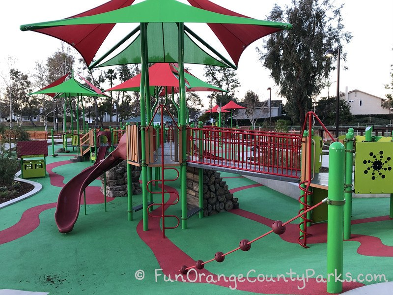 playground with green and red shade cover