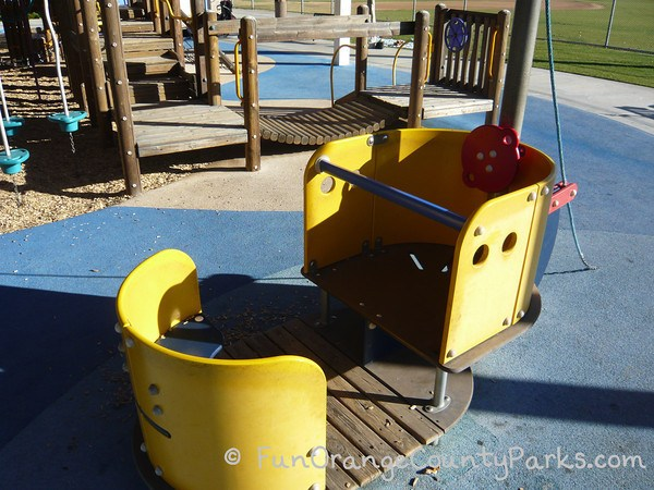 a small platform which resembles a boat with a yellow hull and steering wheel