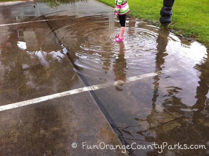 rainy day play ideas - puddle jumping