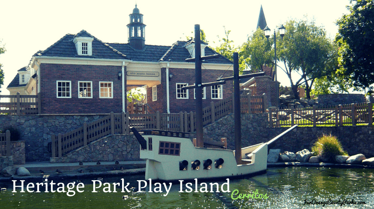 Heritage Park Play Island playground with concrete ship below colonial building