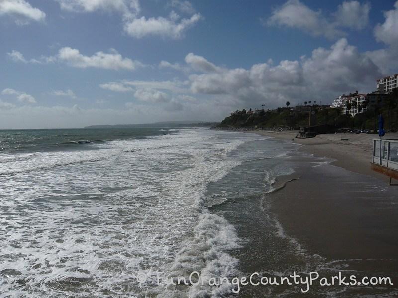 san clemente pier - view of waves crashing at base of pier