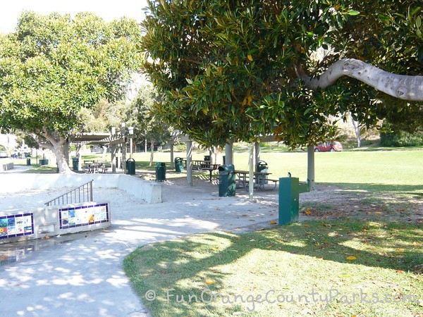 Baby Beach park setting with picnic shelters, trees, and green drinking fountain