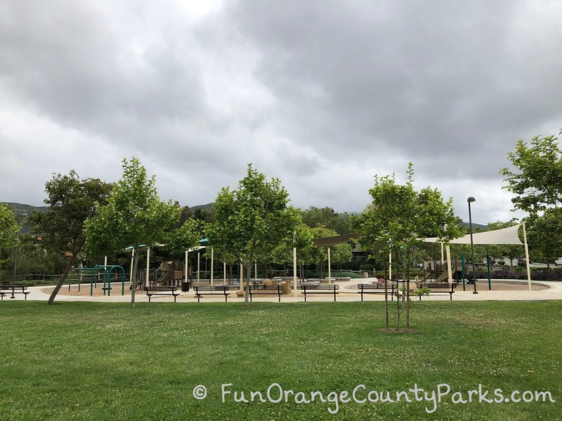 playground equipment with grass in foreground