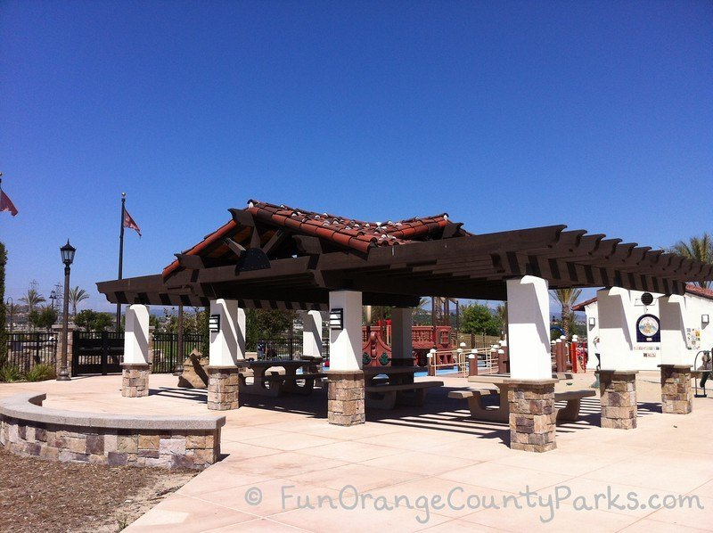 large picnic shelter with red tiled roof and wooden beams