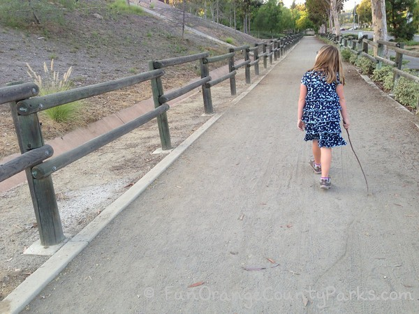 girl with stick on path