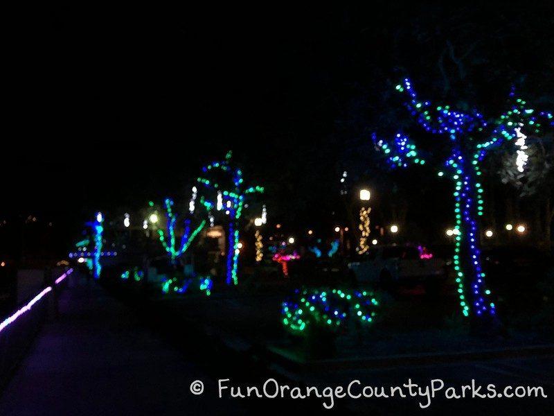 dana point harbor holiday lights blue and green tree decorations