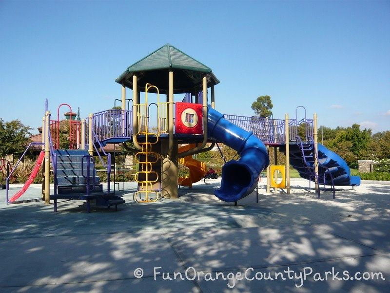 Blue tunnel slide and big playground at Melinda Park in Mission Viejo