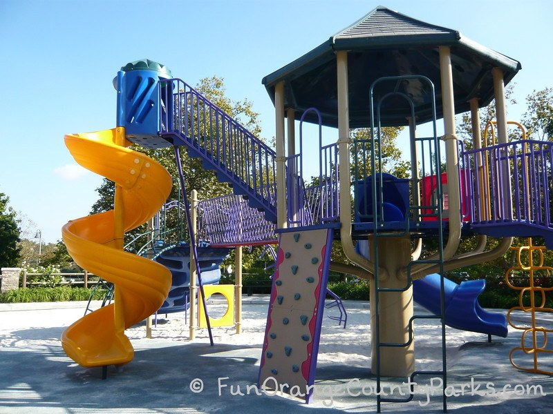 Playground with yellow twisty slide at Melinda Park Mission Viejo