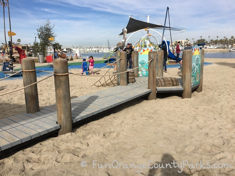 Marina Park playground with pier and play equipment on beach