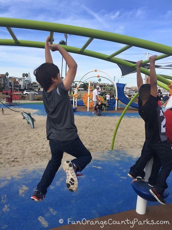 2 boys on monkey bars at Marina Park playground