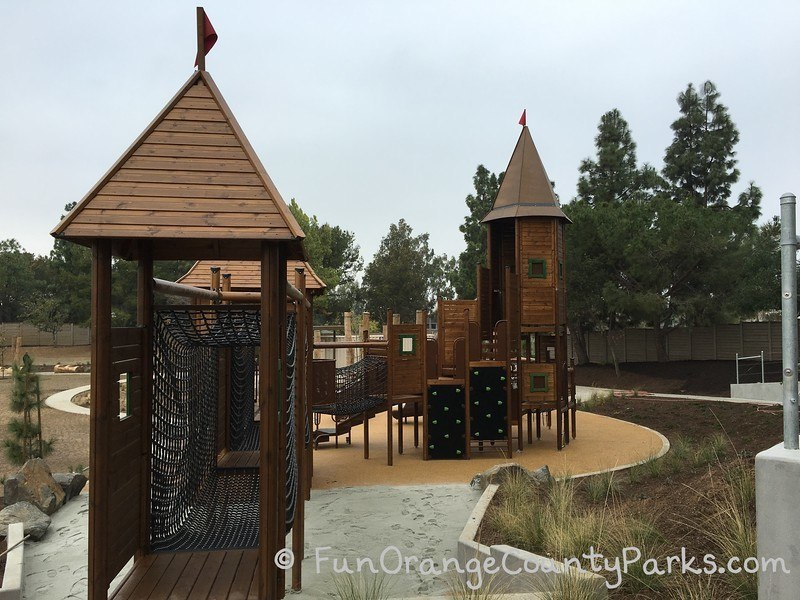 Another view of wooden castle-like playground structure