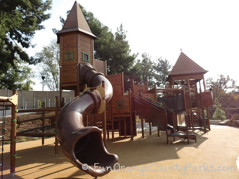 big wooden adventure playground structure reminiscent of a castle design