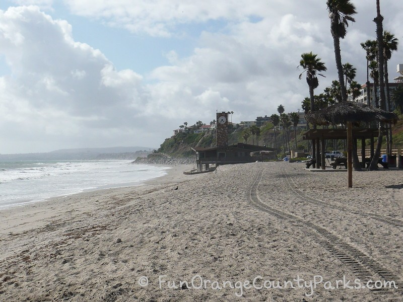 parks and beaches parking passes - san clemente beach near pier with lifeguard station along the sand