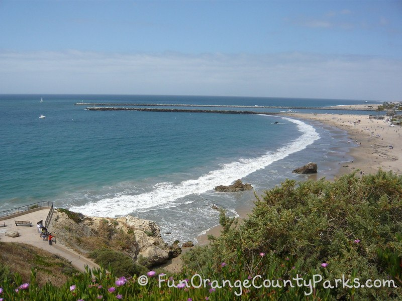 parks and beaches parking passes - corona del mar beach view of beach and Newport Harbor entrance from bluff above the beach