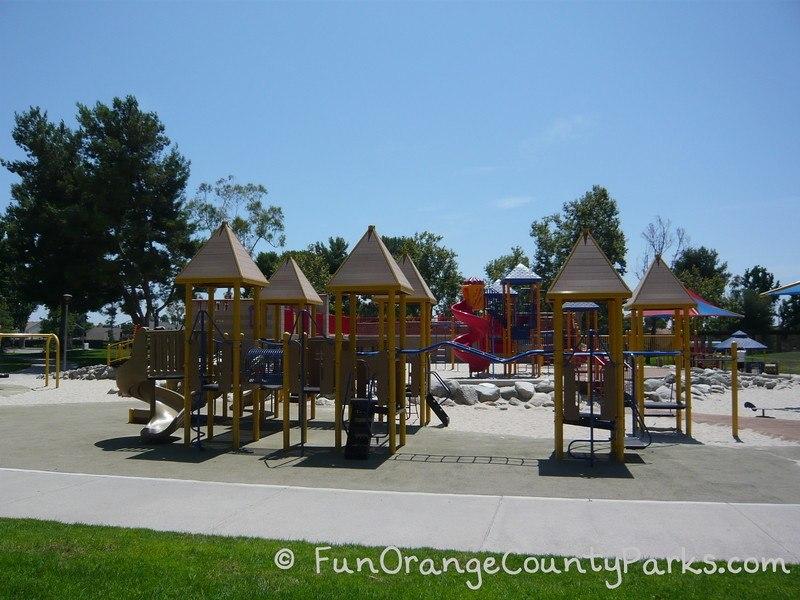 northwood community park irvine playground overview with monkey bars