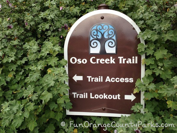 Oso Creek Trail sign with an arrow pointing left for Trail Access and right for Trail Lookout