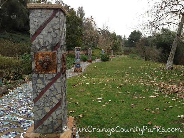 oso creek trail grass area with mosaic art installations