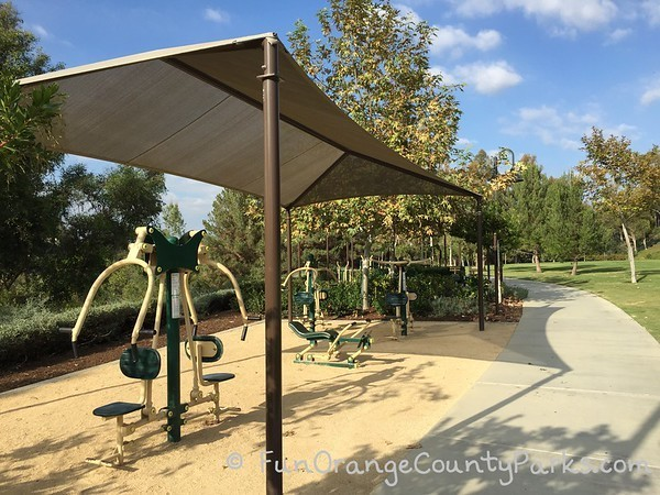 workout equipment at oso viejo park in mission viejo under a sun shade