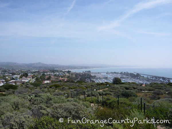view from the top of the Dana Point Headlands over Dana Point Harbor down to San Clemente