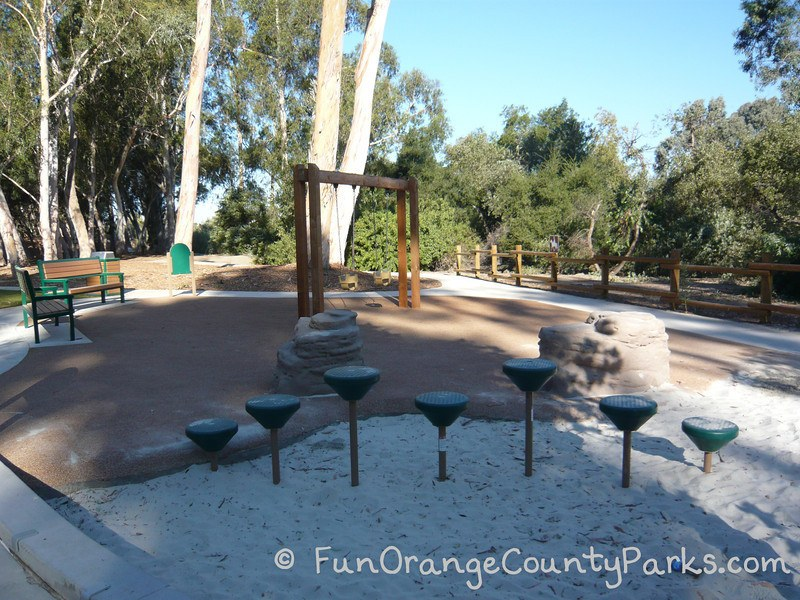 serrano creek park lake forest - pedestal play area and swings