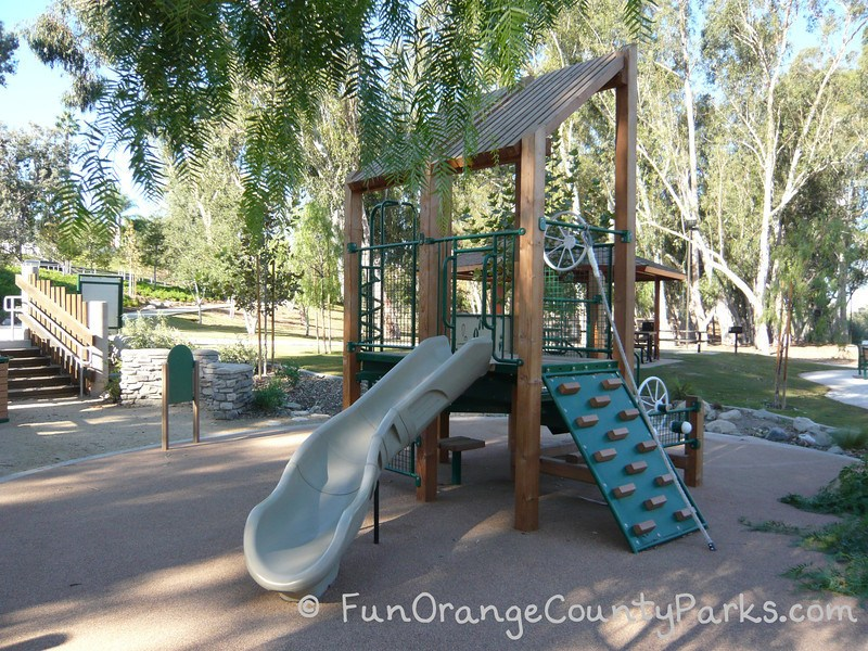 serrano creek park lake forest - playground with slide and steering wheel