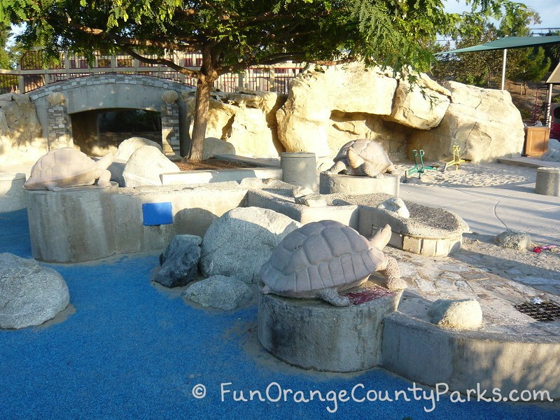 Dinosaur Park Laguna Hills view of turtles and cave area with diggers