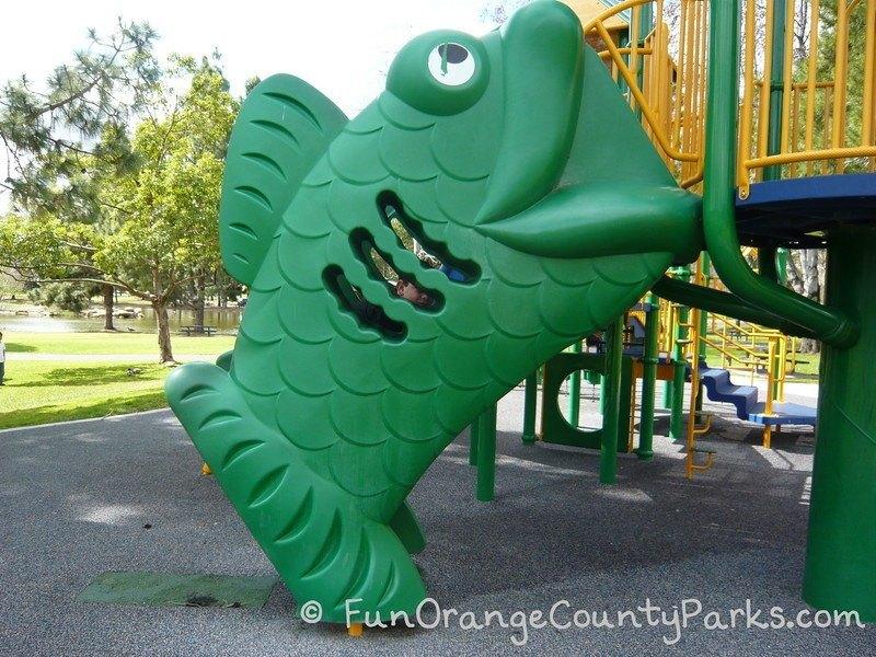 Green fish stair climber onto playground equipment at Yorba Regional Park