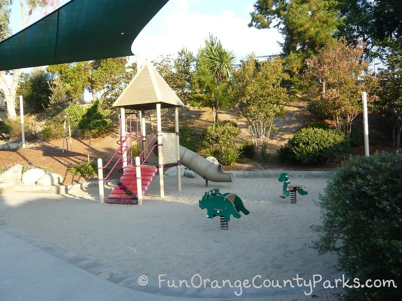 Dino Park in Laguna Hills view of dinosaur spring toys and small childrens playground