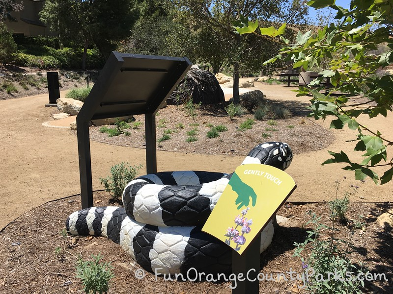 king snake sculpture at play area