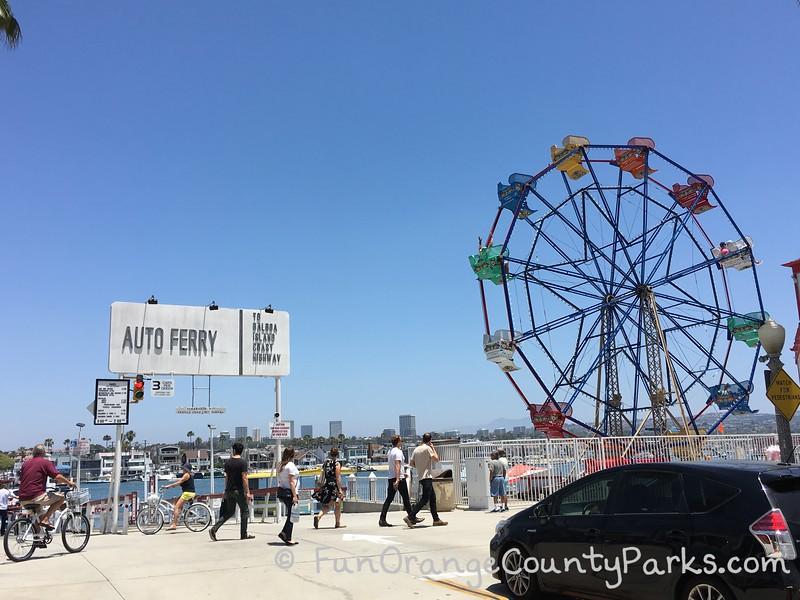 balboa fun zone ferris wheel and auto ferry sign
