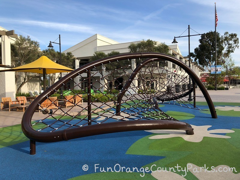 Spiderweb play structure at Woodbridge Center Irvine