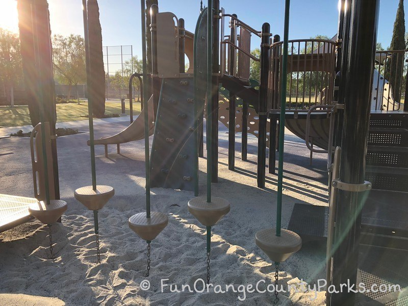 Stonegate Park in Irvine balancing pedestals on smaller play structure.
