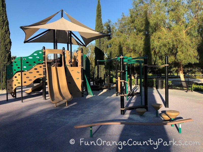 Stonegate Park in Irvine playground equipment for big kids including slides, climber and monkey bars.