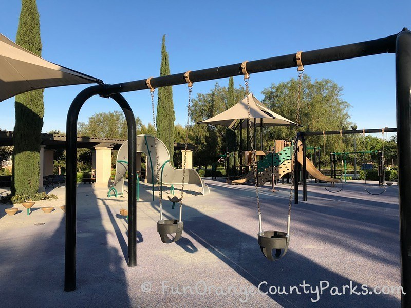 Stonegate Park in Irvine park overview photo with baby swings in the foreground