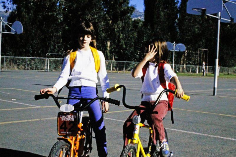 flat biking - girls on bikes at a school playground