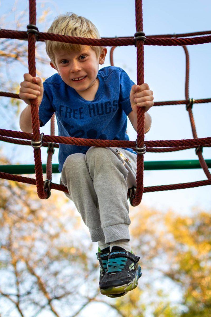 boy on a rope bridge
