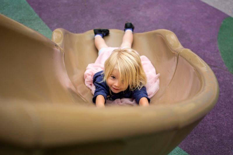girl sliding down slide