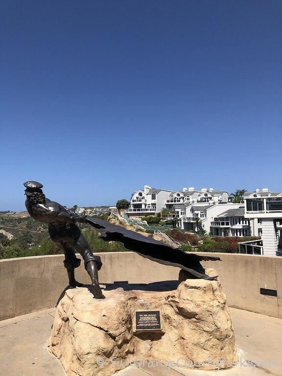 bronze sculpture of man and hide