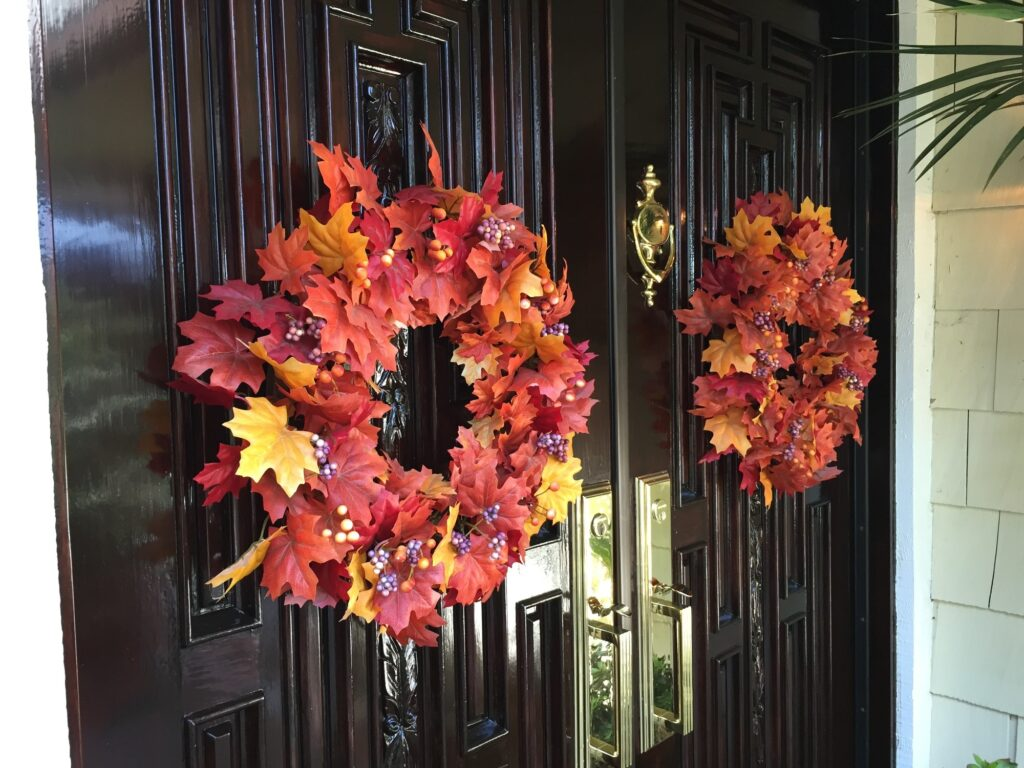 front doors with two fall leaf wreaths