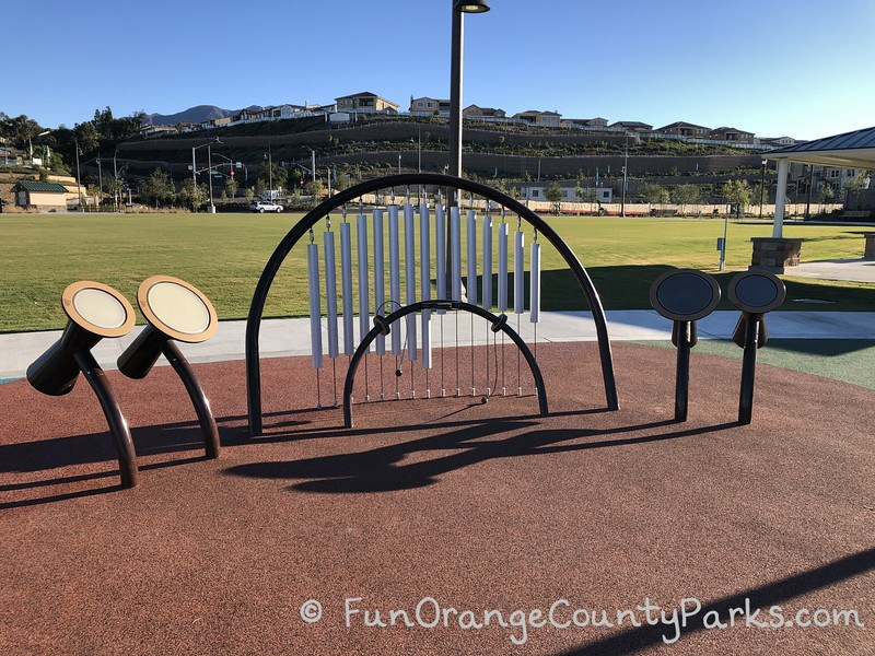 musical instrument playground equipment with large field in background