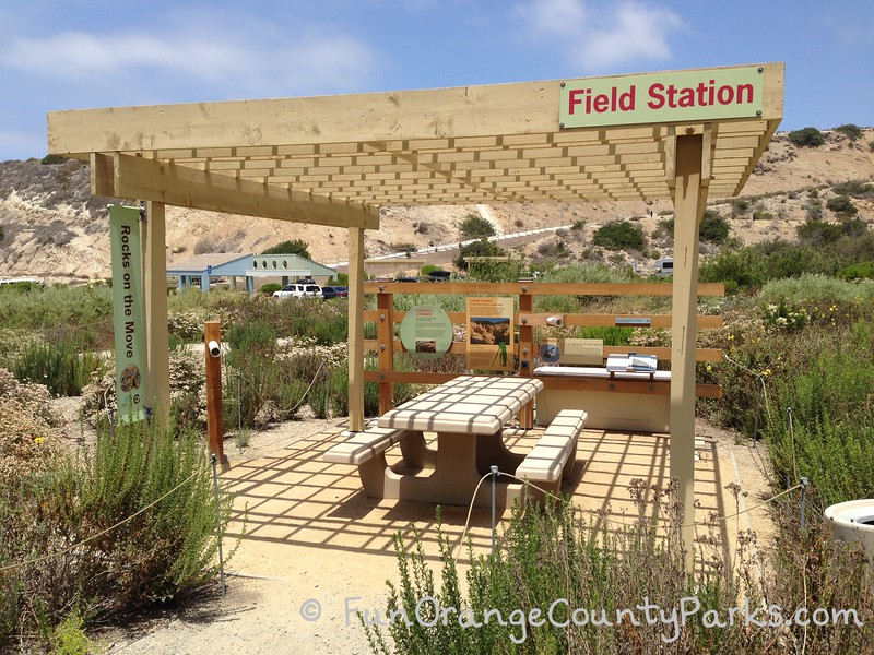 el moro canyon field station picnic area with wooden gazebo over concrete picnic table in a nature area at crystal cove state park